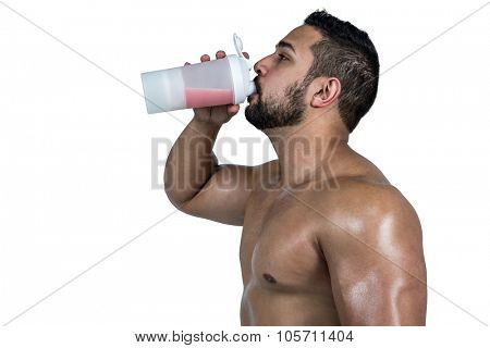 Muscular man with protein powder on white background
