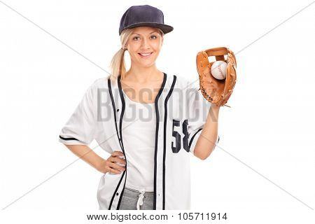 Studio shot of a female baseball player holding a ball in a baseball glove isolated on white background