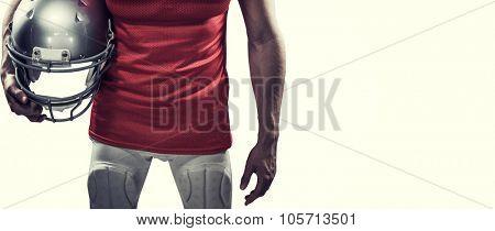American football player holding helmet aside against white background with vignette