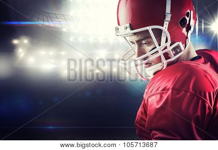 Concentrated american football player against american football arena