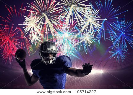 Sportsman throwing football against fireworks exploding over football stadium