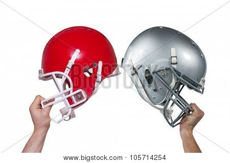 Composite image of american football player handing his helmet