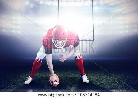 American football player starting football game against american football arena