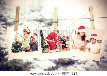 Cute little girl decorating the christmas tree with her father against snow covered trees against sky
