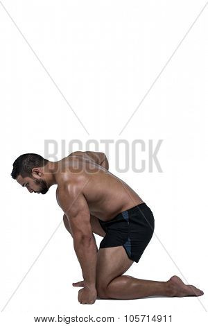 Muscular man flexing for camera on white background