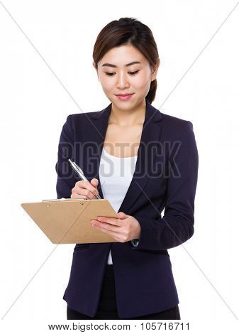 Asian Young Businesswoman take note on clipboard