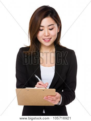 Businesswoman take note on clipboard