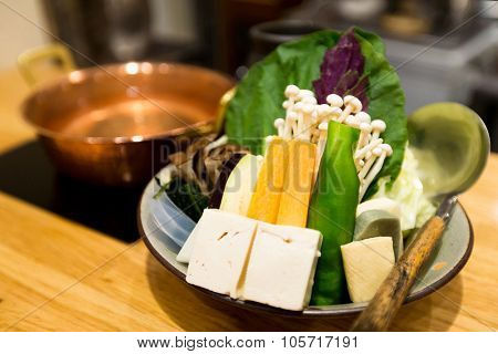 Japanese cuisine, hot pot on background