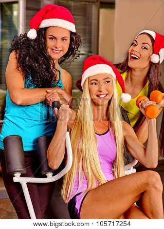 Girls holding dumbbells in sport gym. Sport Christmas concept
