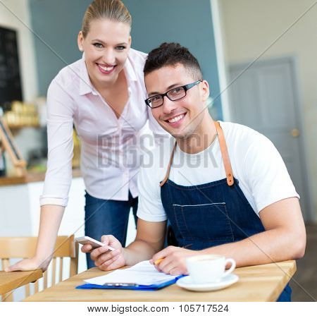 Couple working at cafe