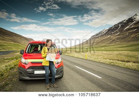Female tourist in Iceland seeing the map