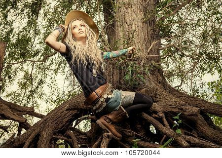 Beautiful boho style girl in the wild wood. Boho, hippie fashion shot.