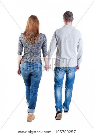 Back view going couple. walking friendly girl and guy holding hands. Rear view people collection. backside view of person. Isolated over white background. Holding hands couple went off.