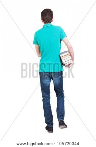 Back view of going  handsome man carries a stack of books. walking young guy . Rear view people collection.  backside view of person.  Isolated over white background.