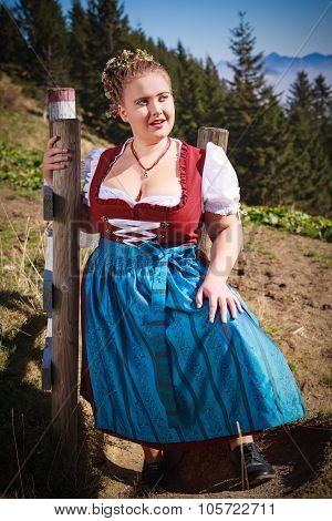 Portrait Of A Young Farmer In The Mountains With Festive Costume