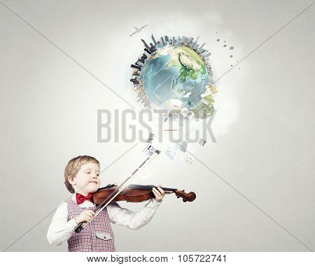 Adorable boy wearing red bowtie and playing violin. Elements of this image are furnished by NASA