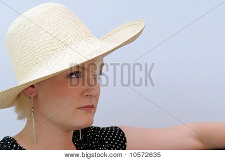Woman Looking in Straw Hat