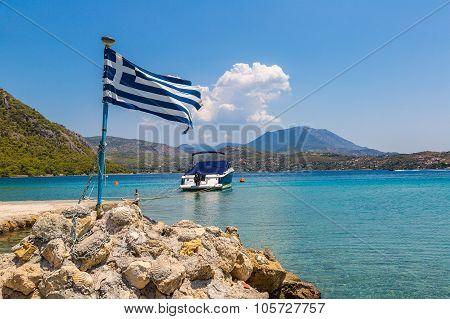 Vouliagmeni Lake And Greek Flag, Greece