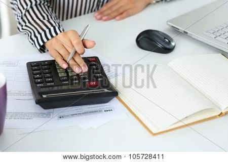 Female Accountant Hand Holding Silver Pen