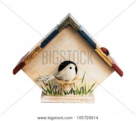 Hand made birdhouse with bird