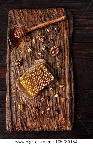 Honey On Wooden Board