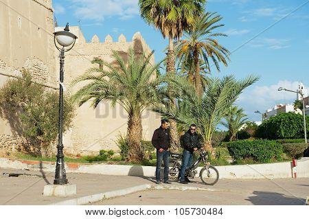 People talk at the street in Sfax, Tunisia.