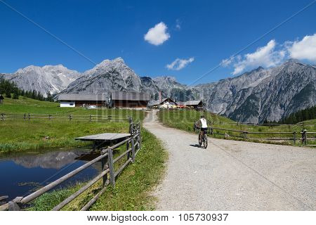 By bike in the mountains alpine summer landscape