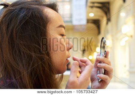 Girl Putting Make-up On