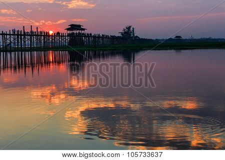 U bein wooden teck bridge with reflections at susnet in Amarapura, Myanmar (Burma)