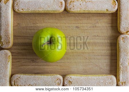 Apple and ladyfinger biscuits, food frame