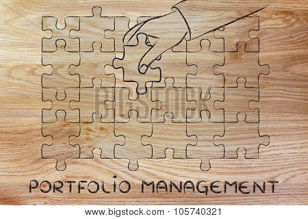 Hand Completing A Puzzle With The Missing Piece, Metaphor Of Portfolio Management