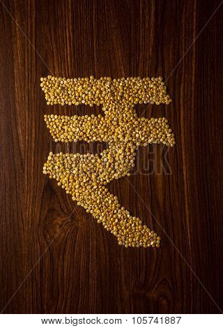 Tur Dal (Indian split lentils) in 'Rupee' symbol shape. Rising food and grain prices in India. A concept.