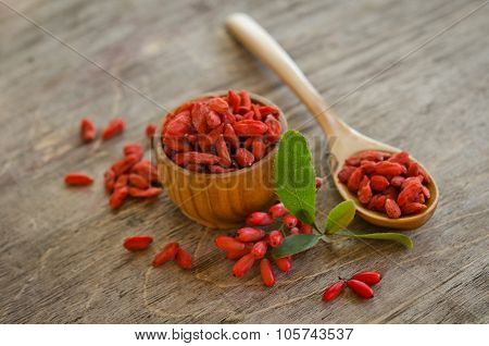 Barberries And Goji Berries On Wooden Background