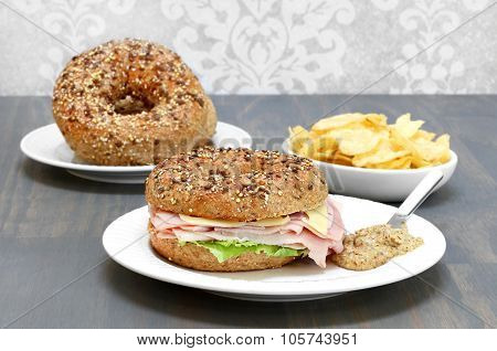 Ham, Swiss Cheese And Lettuce Sandwich On A Multi Grain And Seed Bagel.