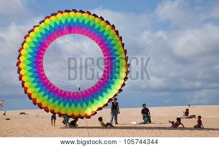 Fuerteventura, Spain - November 08: Viewers Watch From The Ground As Multicolored Kites Fill The Sky