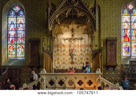 Bruges, Belgium - May 11, 2015: Tourists Visit Interior Of Basilica Of The Holy Blood In Bruges