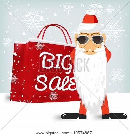 Santa Claus standing near a red big sale shopping bag