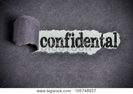 Confidental Word Under Torn Black Sugar Paper