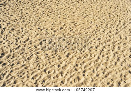 view to sand on beach as textured background