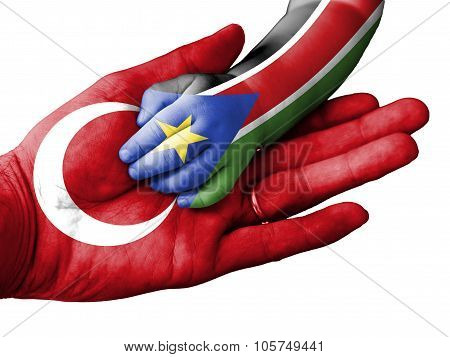 Adult Man Holding A Baby Hand With Turkey And South Sudan Flags Overlaid. Isolated On White