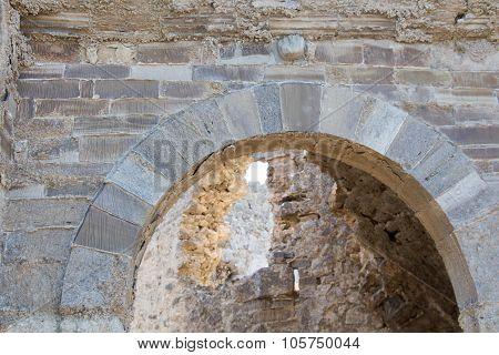 Acient stone gate's top arch detail architecture