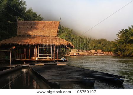 Hut near river and mountain in Thailand