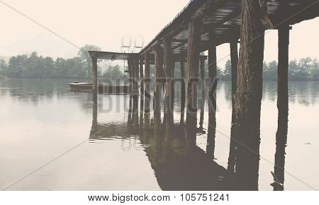 Wooden pier with chairs on Drina lake, Serbia