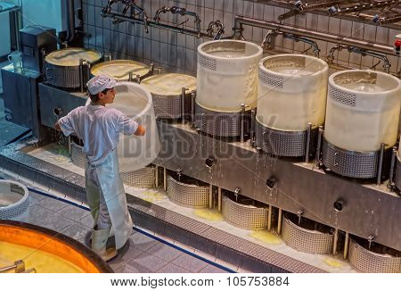 Production Of Gruyere Cheese At The Maison Du Gruyere In Switzerland