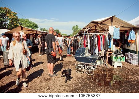 People With Domestic Dogs Spend Time On The Flea Market