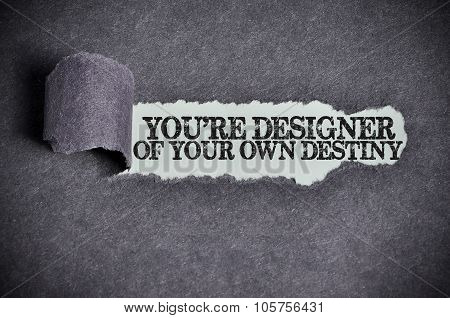 You're Designer Of Your Own Destiny Word Under Torn Black Sugar Paper
