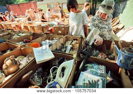 Housewifes Choose The Dishes And Household Utensils On Flea Market