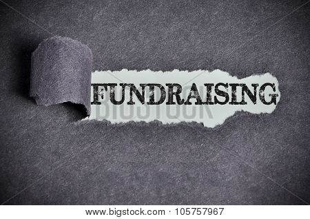 Fundraising Word Under Torn Black Sugar Paper