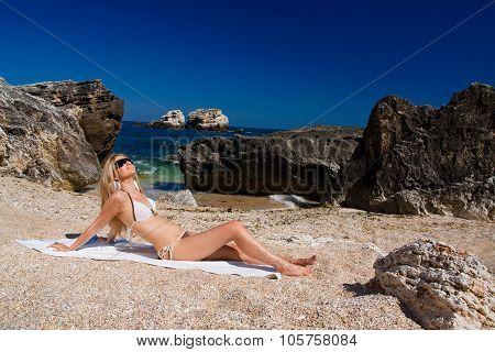 Attractive And Sexy Blonde Girl On The Beach