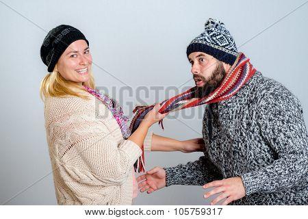 Couple In Winter Dress Joking